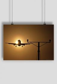 AeroStyle - plakat, lądujący samolot na tle słońca