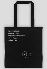 fałdy na torbie